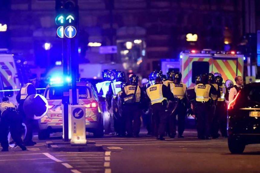 Police arrive at the scene on the London Bridge on June 3, 2017.