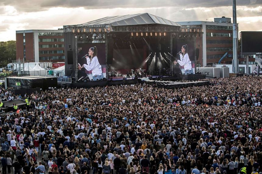 US singer Ariana Grande performs during the One Love Manchester benefit concert for the victims of the Manchester Arena terror attack at Old Trafford on June 4, 2017.