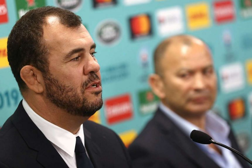 Australia's head coach Michael Cheika (left) speaking to the media beside England's head coach Eddie Jones during a press conference after the Rugby World Cup 2019 pool draw, on May 10, 2017.