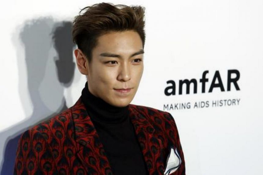 T.O.P, a member of K-pop band Big Bang, has been suspected of smoking the drug four times with an aspiring female singer at his home in Seoul in October last year.