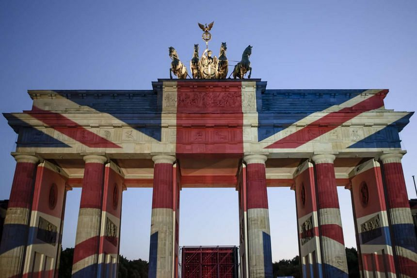 The Brandenburg Gate is illuminated in the colors of the British Union Jack to show solidarity with the victims of the June 3 terror attack in central London on June 4, 2017.
