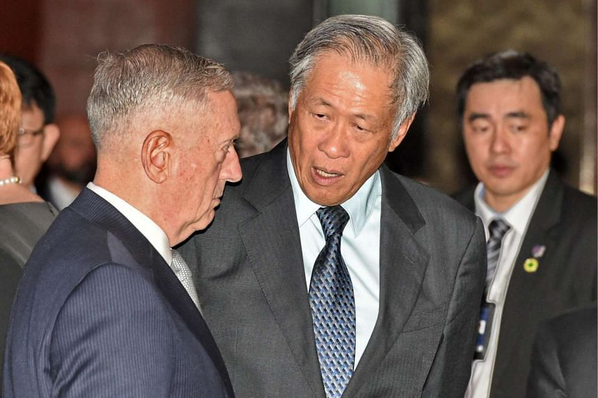 US Pentagon chief Jim Mattis (left) chats with Singapore's Defence Minister Ng Eng Hen (centre) at the Institute for Strategic Studies (IISS), Shangri-La Dialogue summit in Singapore on June 2, 2017.
