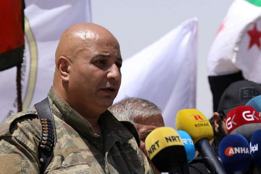 Syrian Democratic Forces (SDF) spokesman Talal Silo speaks during a press conference in Hukoumiya village in Raqqa, Syria on June 6, 2017.
