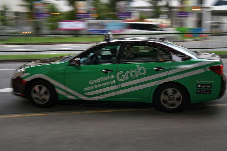 A Grab taxi travelling along Newton Road.