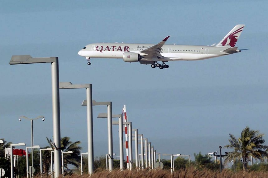 A Qatar Airways plane is seen in Doha.
