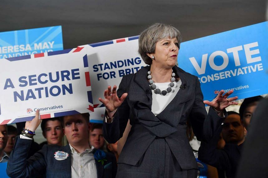 Theresa May delivers a speech during an election campaign visit, June 6, 2017.