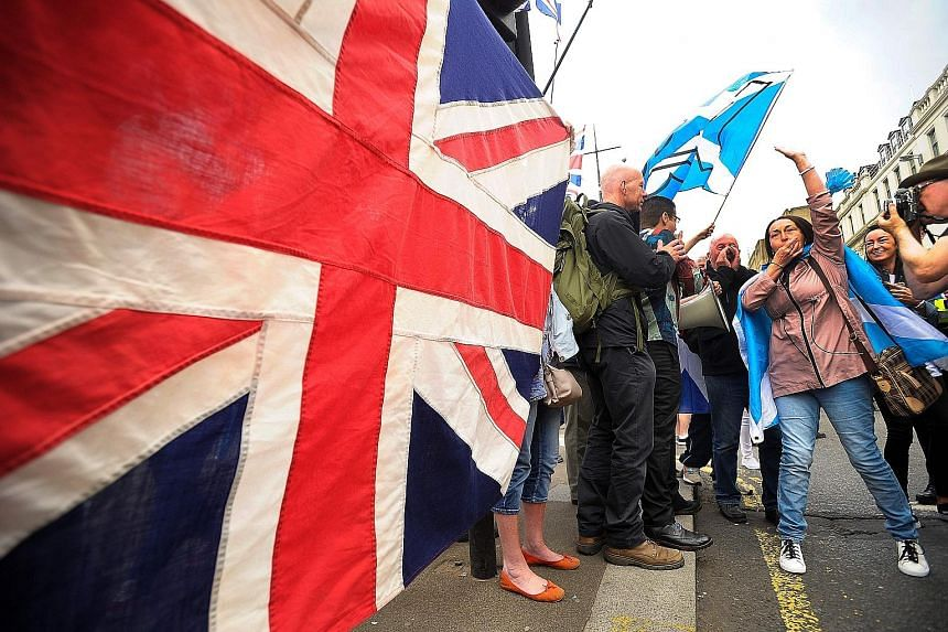 The Union flag playing a large role at a march in Glasgow. Some voters are becoming upset at Scottish National Party leader Nicola Sturgeon's insistence on a second independence referendum. Ms Sturgeon (top left) with the candidate for the Paisley co