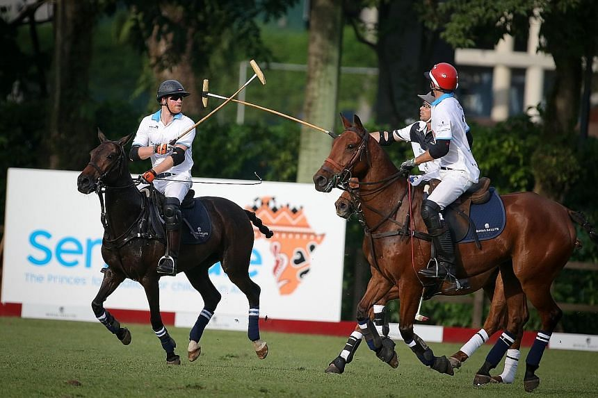 Prince Harry (left) congratulating with his team mates while playing at the Sentebale Royal Salute Polo Cup, which raises funds for Sentebale, a charity for young people living with and affected by HIV in southern Africa.