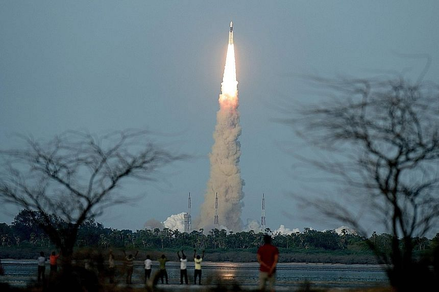 """The 640-tonne rocket, the GSLV Mark-III - nicknamed """"Fat Boy"""" - taking flight from the space centre at Sriharikota in Andhra Pradesh yesterday, carrying with it the heaviest satellite to be launched from Indian soil."""