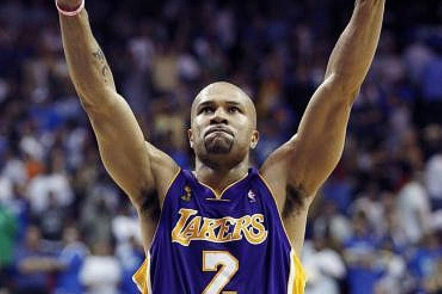 Former LA Lakers guard Derek Fisher in happier times, celebrating his ex-team's 99-91 win in overtime over the Orlando Magic to seal Game Four of the 2009 NBA Finals, which they went on to win.