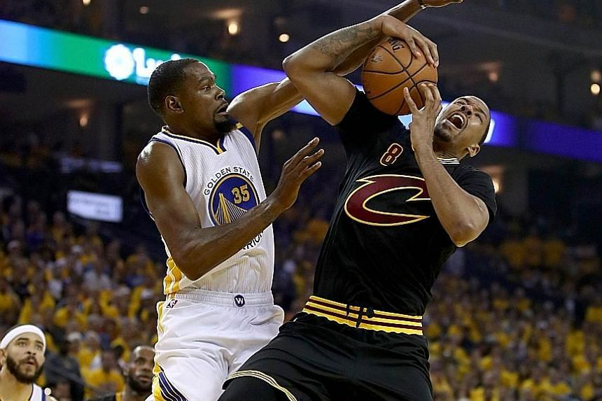 Kevin Durant of the Golden State Warriors blocking Channing Frye of the Cleveland Cavaliers in Game Two of the NBA Finals series. Durant, who ran the floor and defended the rim, had a game-high 33 points in his side's 132-113 victory.