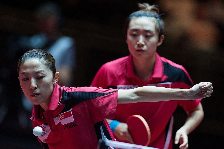 Singapore duo Feng Tianwei and Yu Mengyu (left) in action against China's Chen Meng and Zhu Yuling during their semi-final tie at the WTTC World Table Tennis Championships in Dusseldorf, Germany.