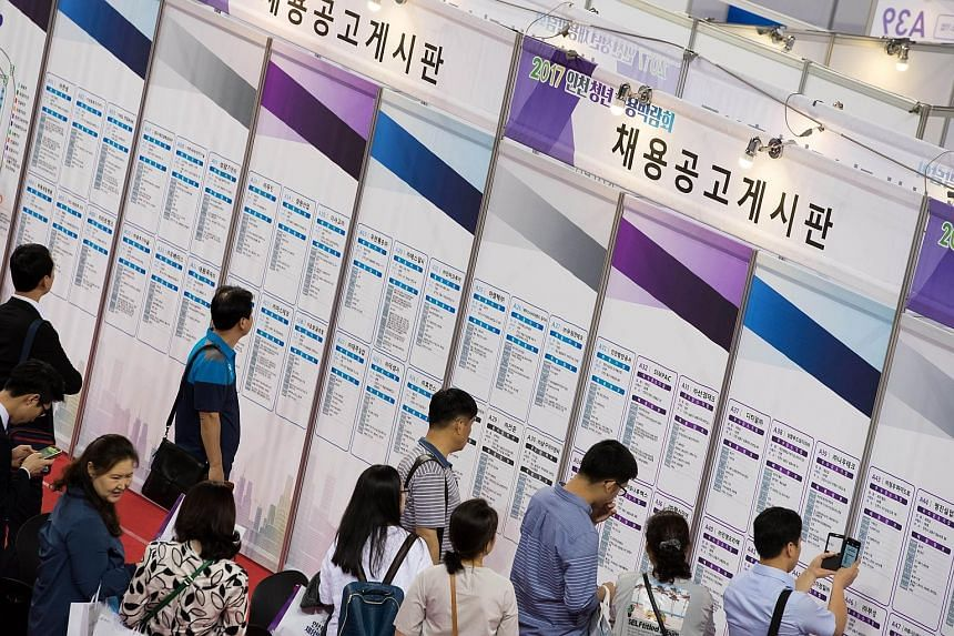 A job fair in Incheon, South Korea, last month. Unemployment among under-30s hit 11.2 per cent in April, more than double the rate for the entire working population. Under new proposals, Seoul will spend 4.2 trillion won (S$5 billion) to help create