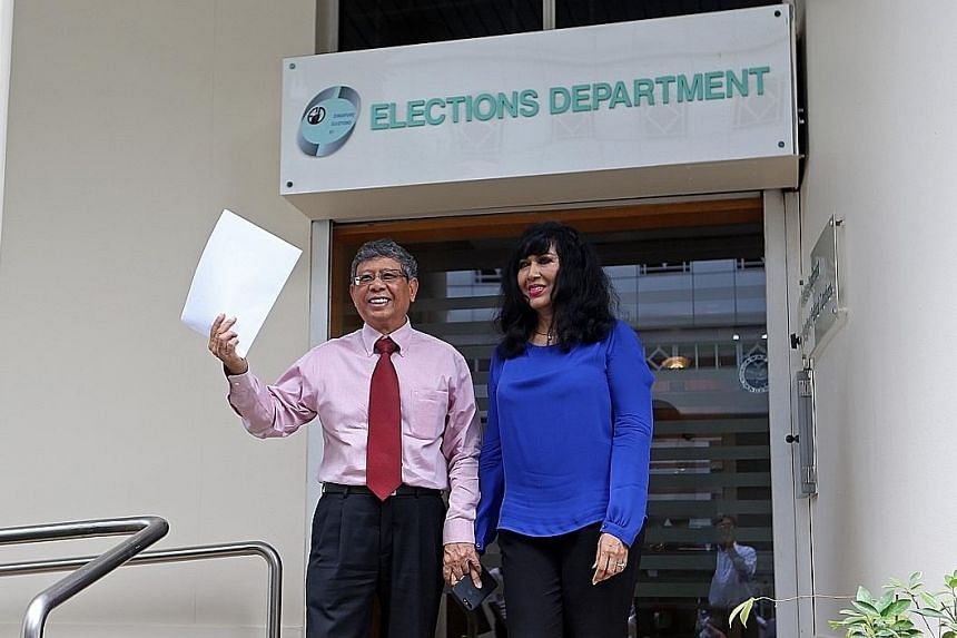 Second Chance Properties CEO Mohamed Salleh Marican with his wife Sapiyah Abu Bakar after collecting application forms for this September's presidential polls at the Elections Department yesterday.