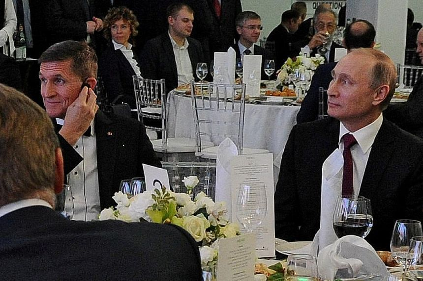 Russian President Vladimir Putin (right) with Mr Michael Flynn at the anniversary gala for television network Russia Today in Moscow in 2015.