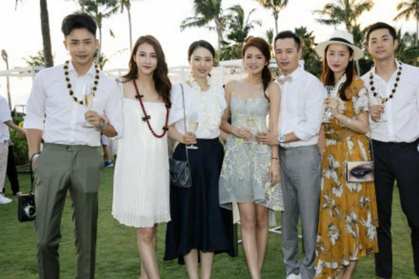 Actress Ady An (centre) and husband Levo Chan (to her left) gathered with friends at a welcome party on the eve of their wedding.