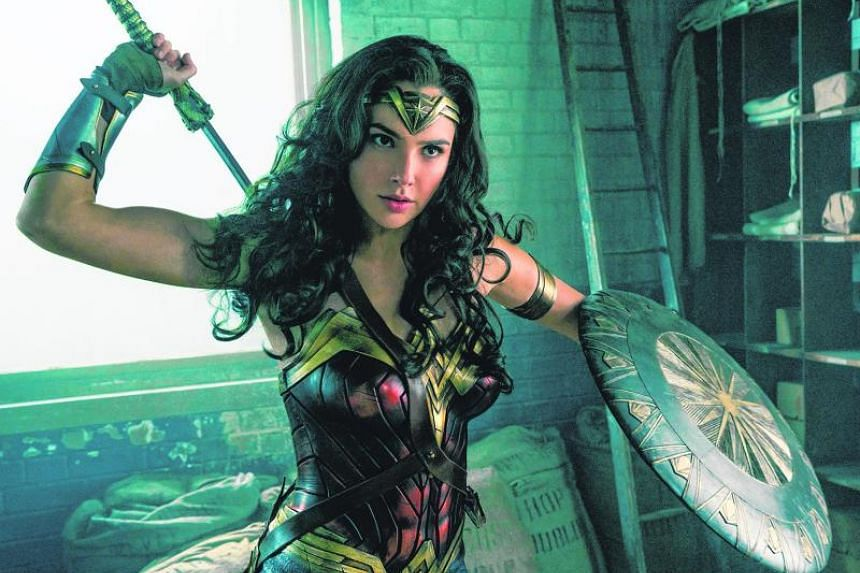 Gal Gadot as Wonder Woman. The actress was Miss Israel in 2004 and also served two years in the Israeli army.