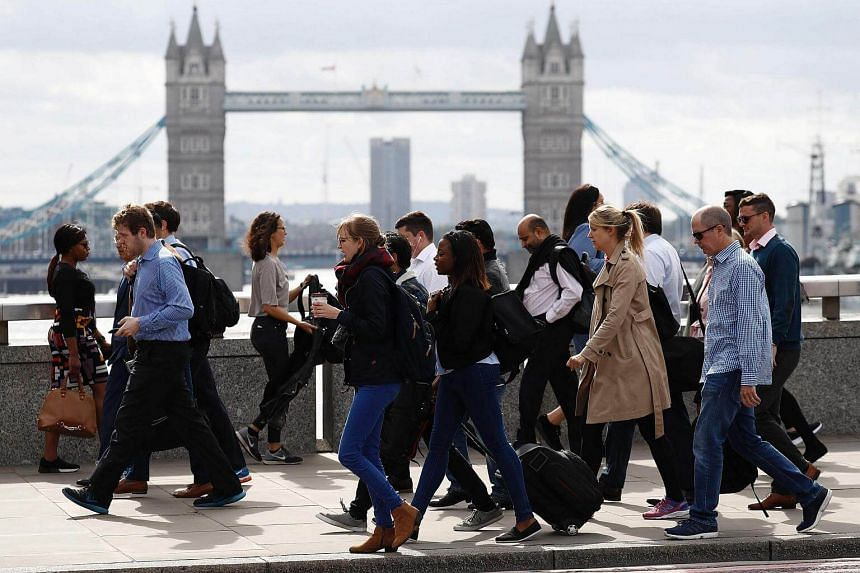 Commuters walking across London Bridge, on June 5, 2017, after it was partially re-opened following the June 3 terror attack.