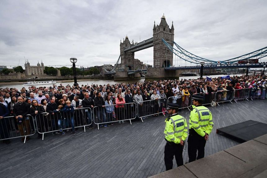 People taking part in a vigil for victims of the London Bridge terror attacks by the City Hall, on June 5, 2017.