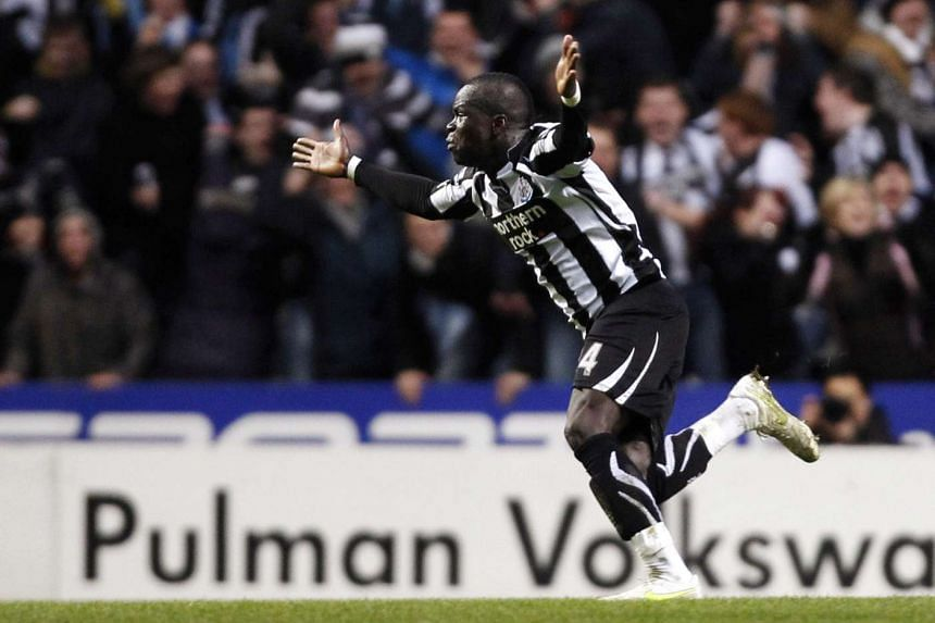 Cheick Tiote celebrates after scoring a goal for Newcastle in 2011.