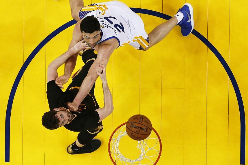 Golden State Warriors player Zaza Pachulia (R) goes for rebound against Cleveland Cavaliers player Kevin Love (L) in game two of the NBA Finals basketball game at Oracle Arena in Oakland, California, USA, 04 June 2017.