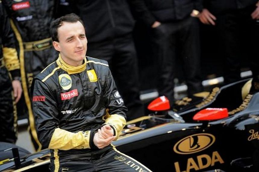 Lotus Renault's Polish driver Robert Kubica poses during the presentation of the new Lotus Renault GP R31 at Ricardo Tormo racetrack in Spain on Jan 31, 2011.
