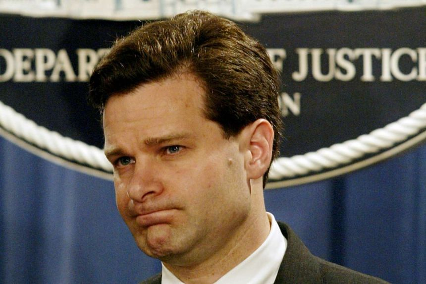 Assistant U.S. Attorney General Christopher Wray pauses during a press conference at the Justice Department in Washington, U.S. November 4, 2003.