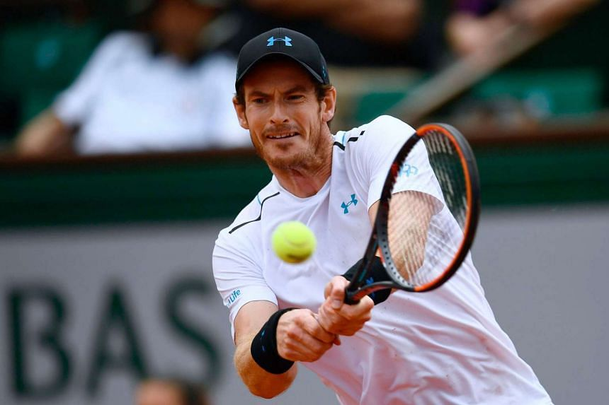 Britain's Andy Murray returns the ball to Russia's Karen Khachanov during their tennis match at the Roland Garros 2017 French Open in Paris on June 5, 2017.