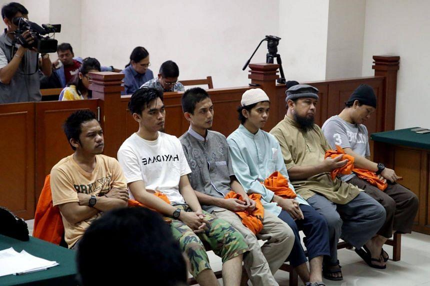 Batam terror cell members (from right) Eka Saputra, Trio Syafidro, Tarmidzi, Gigih Rahmat Dewa, Hadi Gusti Yanda, and Leonardo Hutajulu, at the East Jakarta District Court on June 7, 2017.