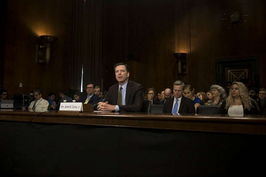 James Comey testifies before a Senate committee, on Capitol Hill.