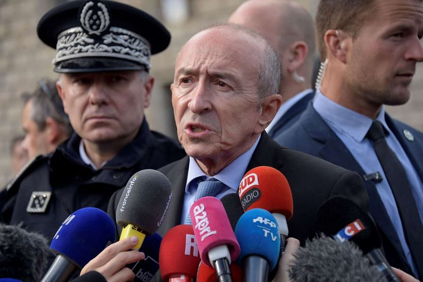 French Minister of the Interior Gerard Collomb addresses the media.