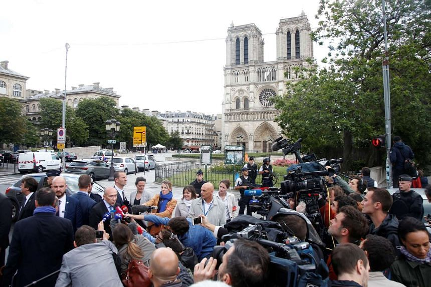 French Interior Minister Gerard Collomb talks to journalists at the scene.
