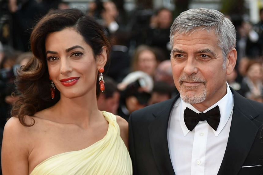 George Clooney and his wife Amal at the Cannes Film Festival in 2016.