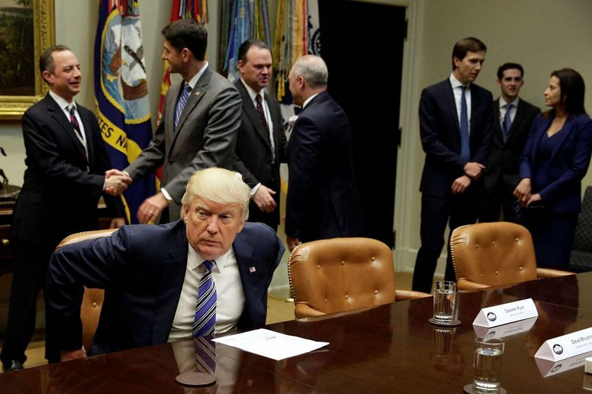 Trump takes his seat during a meeting with Republican Congressional leaders, June 6, 2017.