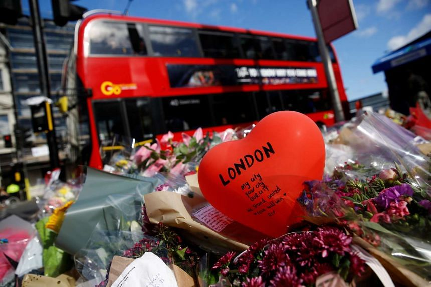 Floral tributes are seen near the scene of the recent attack at London Bridge and Borough Market, June 7, 2017.