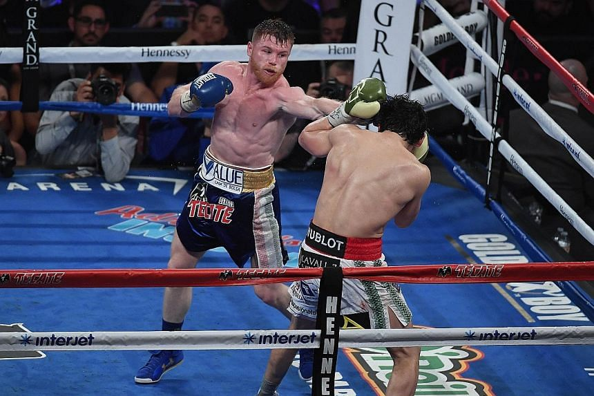 Mexico's Saul Alvarez landing clean punches on compatriot Julio Cesar Chavez Jr in a comfortable unanimous decision win. The middleweight boxer will be hoping to cement his legacy against the undefeated Golovkin of Kazakhstan, one of the sport's most