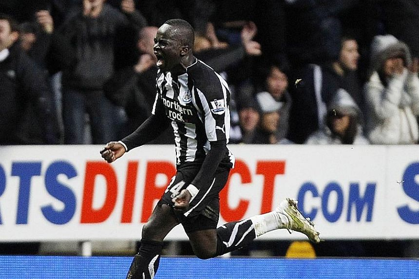 Cheick Tiote celebrating after scoring Newcastle's equaliser against Arsenal in the amazing 4-4 draw back in 2011. The crowd favourite with the Magpies, who are now back in the Premier League, left for China in February.