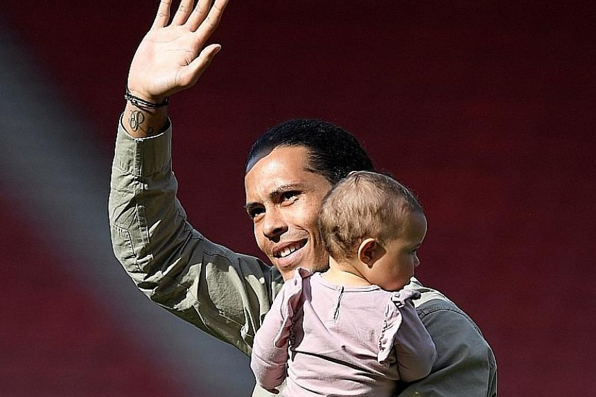 Saints defender Virgil van Dijk waving to fans at their last league game of the season against Stoke. The Dutchman is clamouring for a move to Anfield.