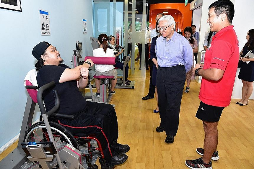 Former nurse Mohammad Sabree Salleh (far left) with President Tony Tan Keng Yam and ActiveSG senior fitness instructor Alan Chong at the Enabling Village yesterday. Dr Tan emphasised the need for a more inclusive Singapore.