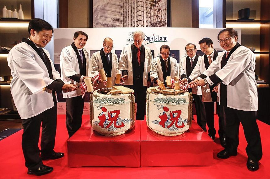 CapitaLand yesterday marked the launch of Ascott Marunouchi Tokyo with a sake-barrel opening ceremony, officiated by Emeritus Senior Minister Goh Chok Tong. He was joined by (from left) Mr Kevin Goh, chief operating officer, Ascott; Mr Lim Ming Yan,