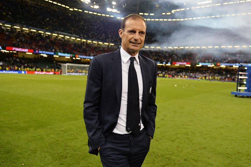 Juventus coach Massimiliano Allegri walks off the pitch after the Uefa Champions League final between Juventus FC and Real Madrid at the National Stadium of Wales in Cardiff, Britain, on June 3, 2017.