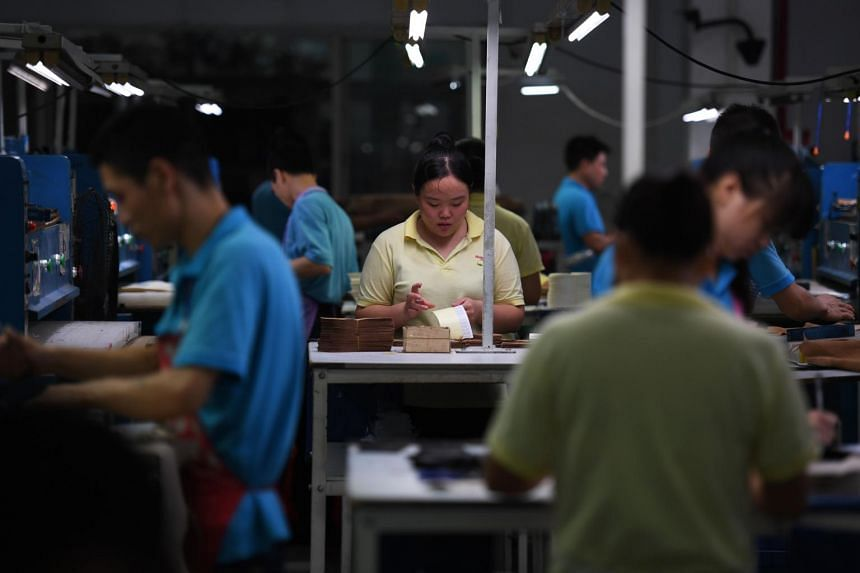 Workers on a production line at the Huajian shoe factory, where Ivanka Trump-branded shoes have been made over the years amongst other brands, in Dongguan, southern China's Guangdong province on Sept 14, 2016.