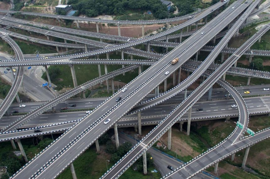Motorists driving on an interchange in Chongqing, southwest China on June 3, 2017.