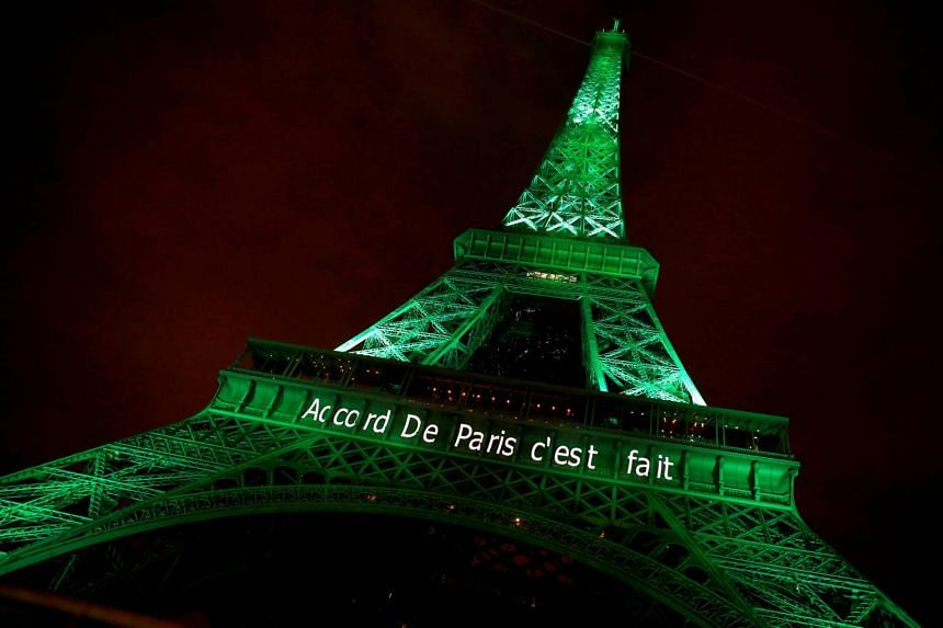 "The Eiffel tower is illuminated in green with the words ""Paris Agreement is Done"", to celebrate the Paris UN COP21 Climate Change agreement in Paris, France, on Nov 4, 2016."