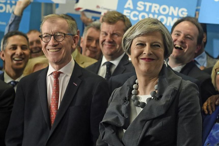 British Prime Minister Theresa May, seen here with her husband Philip on the campaign trail on Tuesday (June 6), was riding high when she called a snap election on April 18, but has seen her popularity wane in recent weeks.