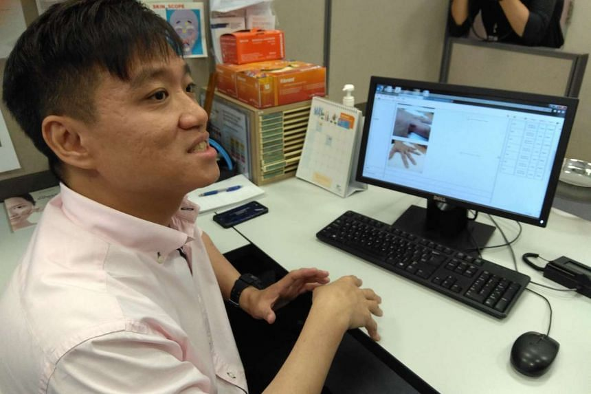 Dr Yew Yik Weng, consultant at the National Skin Centre, doing a mock-demonstration of the Tele-Derm e-consult service.