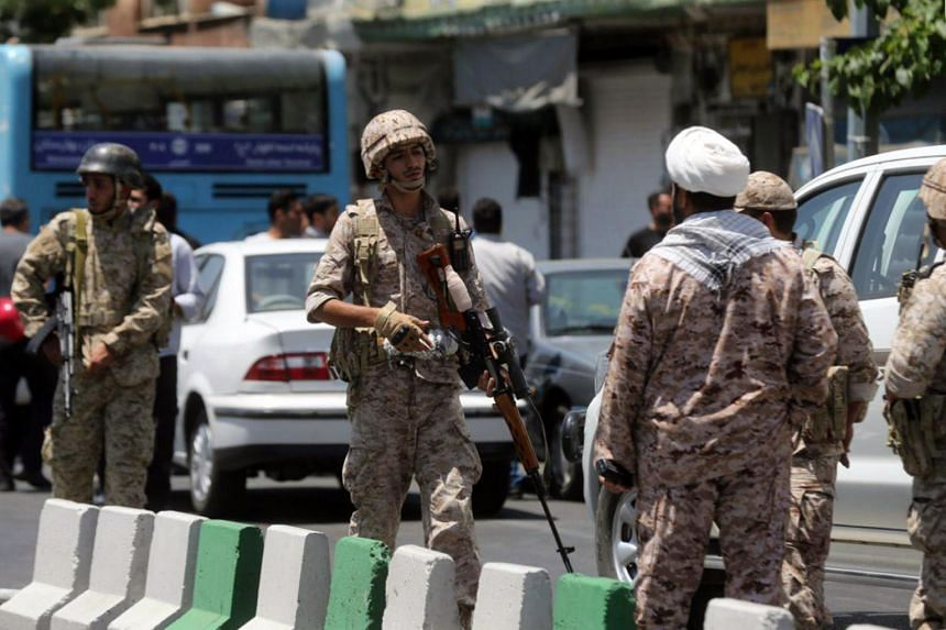 Members of the Iranian Revolutionary Guard secure the area outside the Iranian parliament during an attack on the complex in the capital Tehran on June 7, 2017.