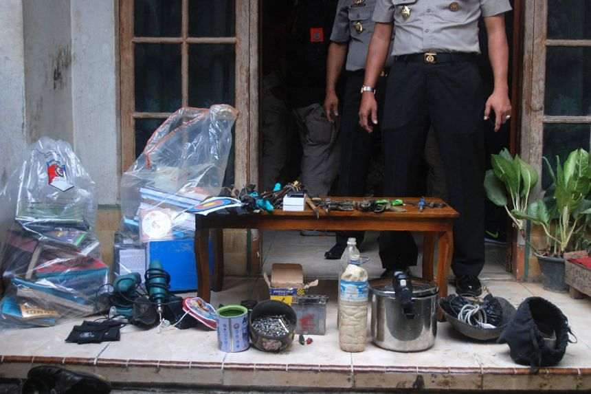 Indonesian police conducting a house raid in Cileunyi, Bandung, West Java province, where they arrested two suspects and seized evidence, on June 6, 2017.