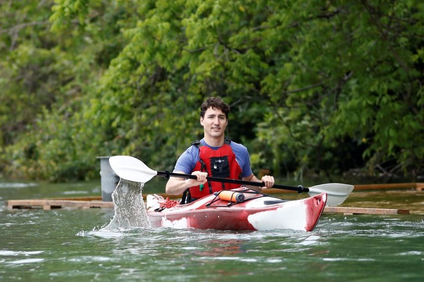 Canada's Prime Minister Justin Trudeau paddles a kayak to mark World Environment Day on the Niagara River, that borders with the United States, in Niagara-on-the-Lake, Ontario, Canada on June 5, 2017.