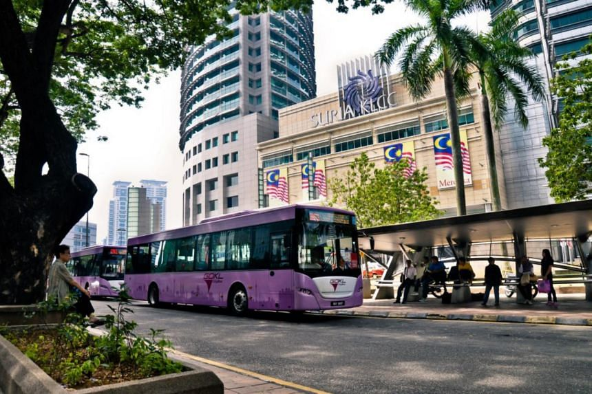 Go-KL buses waiting for passengers outside the popular Suria KLCC shopping mall in downtown Kuala Lumpur.